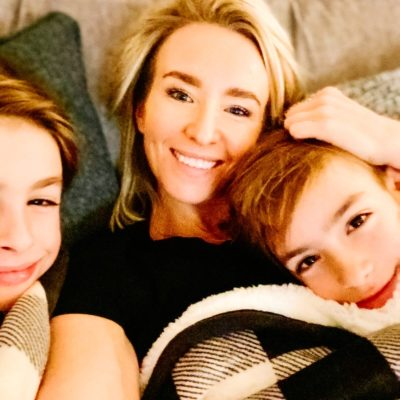 Ashleigh Renard and two children cuddling on couch