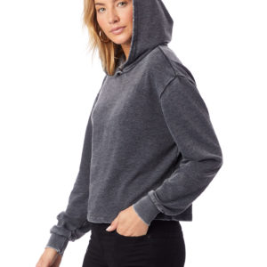 Blonde woman in grey hoodie and black jeans